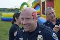 Police officer with face painted for carnival event